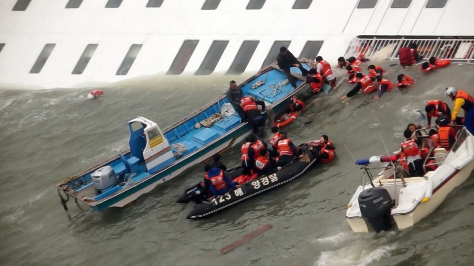 Sewol ferry passengers rescued by South Korean Coast Guard personnel in the water off the southern coast near Jindo, south of Seoul on April 16, 2014. (AP / Yonhap)