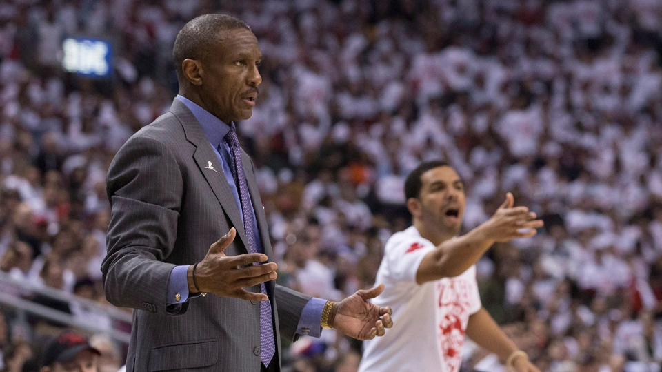 Toronto Raptors' Head Coach Dwane Casey and rapper Drake react during the Raptors 94-87 loss to the Brooklyn Nets in NBA playoff basketball action in Toronto on Saturday, April 19, 2014. (Chris Young / THE CANADIAN PRESS)