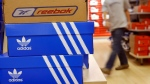 Reebok and Adidas shoe boxes in a department store on Aug. 3, 2005. (AP / Wolfram Steinberg)