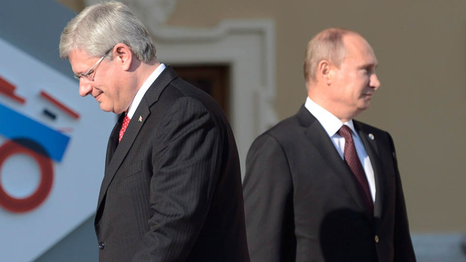Prime Minister Stephen Harper and Russian President Vladimir Putin in St. Petersburg, Sept. 5, 2013. Russia has expelled a Canadian diplomat from Moscow, government sources confirm to CTV News. (Adrian Wyld / THE CANADIAN PRESS)