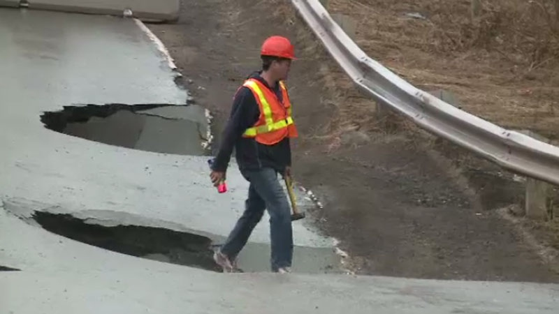 Large sinkholes on Route 114 in Lower Coverdale have closed a section of the road to traffic. (CTV Atlantic)