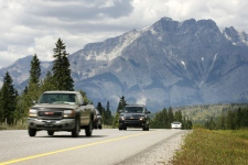 Vehicles drive along the Trans Canada Highway through Banff National Park with Mt. Cascade in the background, on Tuesday, Aug. 5, 2008. (Jeff McIntosh / THE CANADIAN PRESS)
