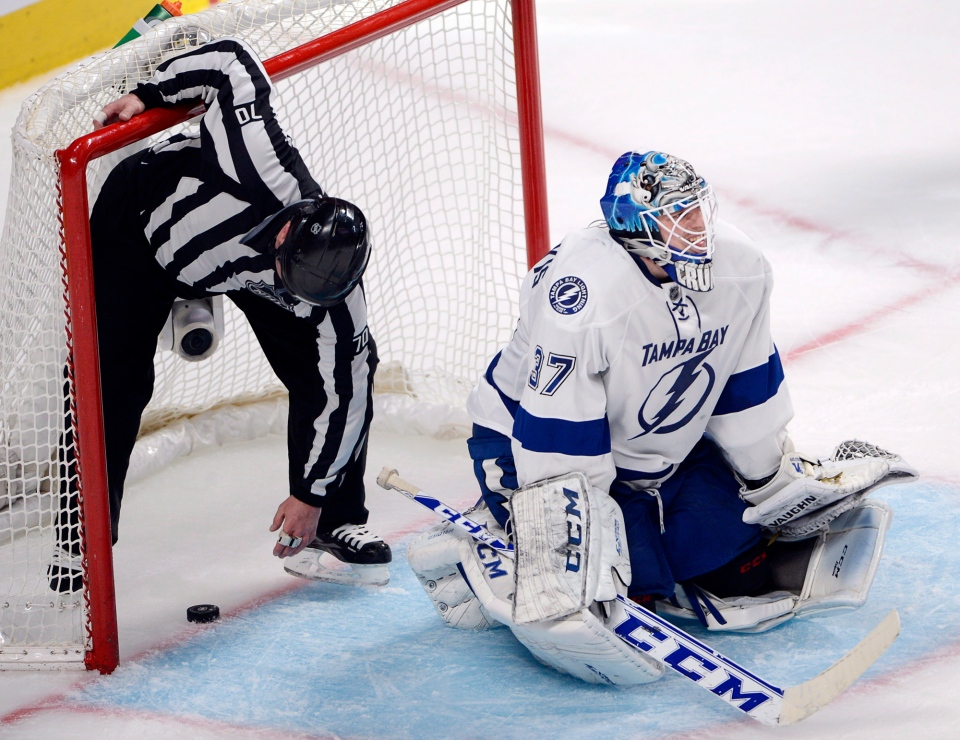 Tampa Bay Lightning goalie Kristers Gudlevskis (37) reacts after letting in the winning goal in a 4-3 loss to the Montreal Canadiens during third period National Hockey League Stanley Cup playoff action on Tuesday, April 22, 2014 in Montreal. THE CANADIAN PRESS/Ryan Remiorz
