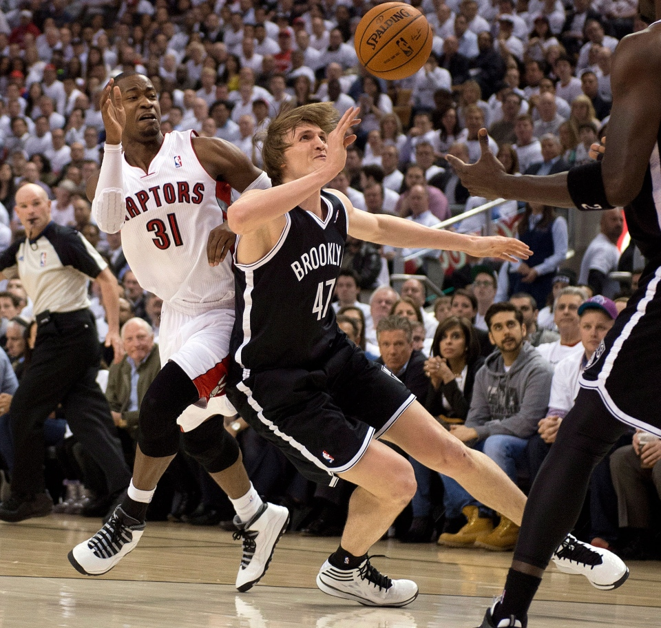 Toronto Raptors guard Terrence Ross (31) and Brooklyn Nets forward Andrei Kirilenko (47) collide while chasing a loose ball during first half NBA first round playoff action in Toronto on Tuesday, April 22, 2014. (Frank Gunn / THE CANADIAN PRESS)