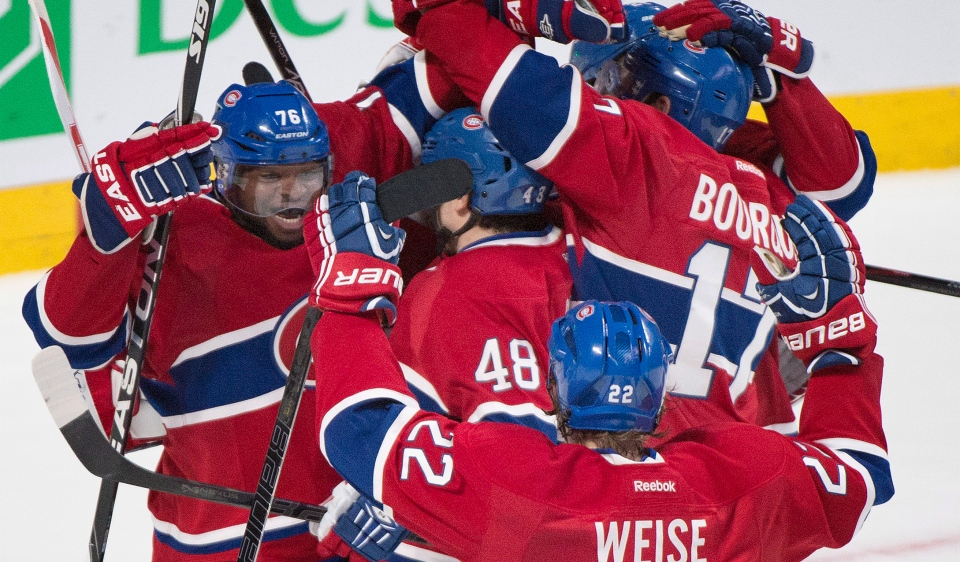 Montreal Canadiens celebrate after defeating the Tampa Bay Lightning in NHL Stanley Cup playoff action in Montreal, Tuesday, April 22, 2014. (Graham Hughes / THE CANADIAN PRESS)