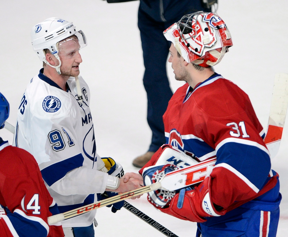 Tampa Bay Lightning centre Steven Stamkos shakes hands with Montreal Canadiens goalie Carey Price after Montreal defeated Tampa Bay 4-3 to win their National Hockey League Stanley Cup playoff series four games to none Tuesday, April 22, 2014 in Montreal. (Ryan Remiorz / THE CANADIAN PRESS)