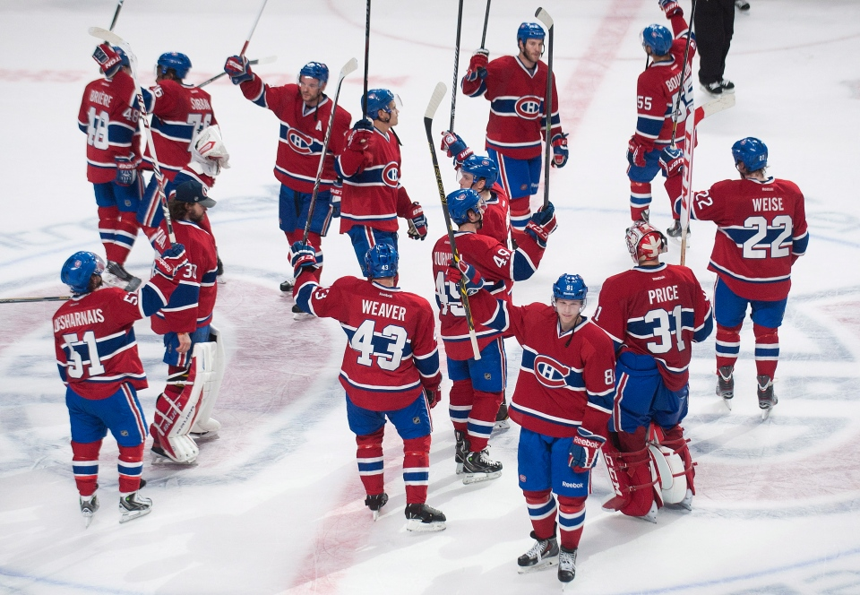Players from the Montreal Canadiens salute the crowd after defeating the Tampa Bay Lightning in NHL Stanley Cup playoff action in Montreal, Tuesday, April 22, 2014. THE CANADIAN PRESS/Graham Hughes