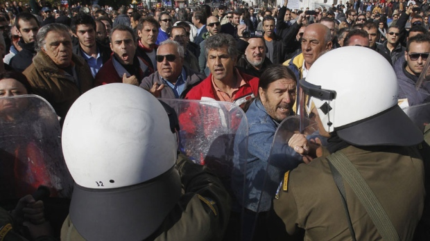 Anti-austerity protesters scuffle with riot police in Athens on Oct. 28, 2011