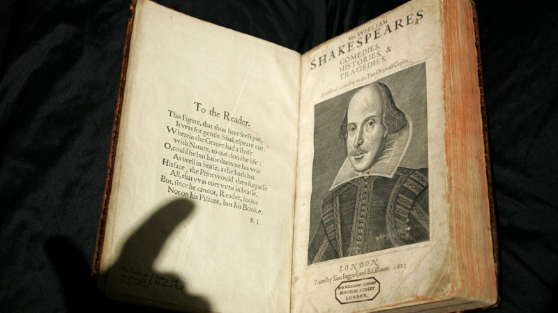 The shadow of the hand of a Sotheby's employee is cast over a 17th century calf bound 1623 copy of the First Folio edition of William Shakespeare's plays at the auction house's offices in central London, Thursday March 30, 2006.