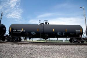 In this Aug. 8, 2012 photo, a DOT-111 rail tanker passes through Council Bluffs, Iowa. (AP Photo/Nati Harnik)