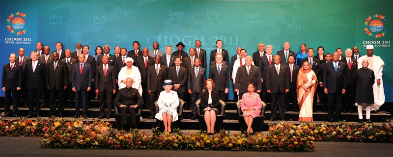 The Queen, sitting second left, is joined by Commonwealth Secretary-General Kamalesh Sharma, sitting left, Australian Prime Minister Julia Gillard, sitting second right, Trinidad and Tobago Prime Minister Kamla Persad-Bissessar, sitting right, and leaders from other Commonwealth nations for the official photo of the Commonwealth Heads of Government Meeting (CHOGM) in Perth, Australia, Friday, Oct. 28, 2011. (AP / Torsten Blackwood)