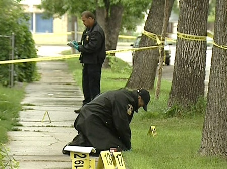 Police continue to investigate the scene where Craig McDougall, 26, was shot and killed by Winnipeg Police.