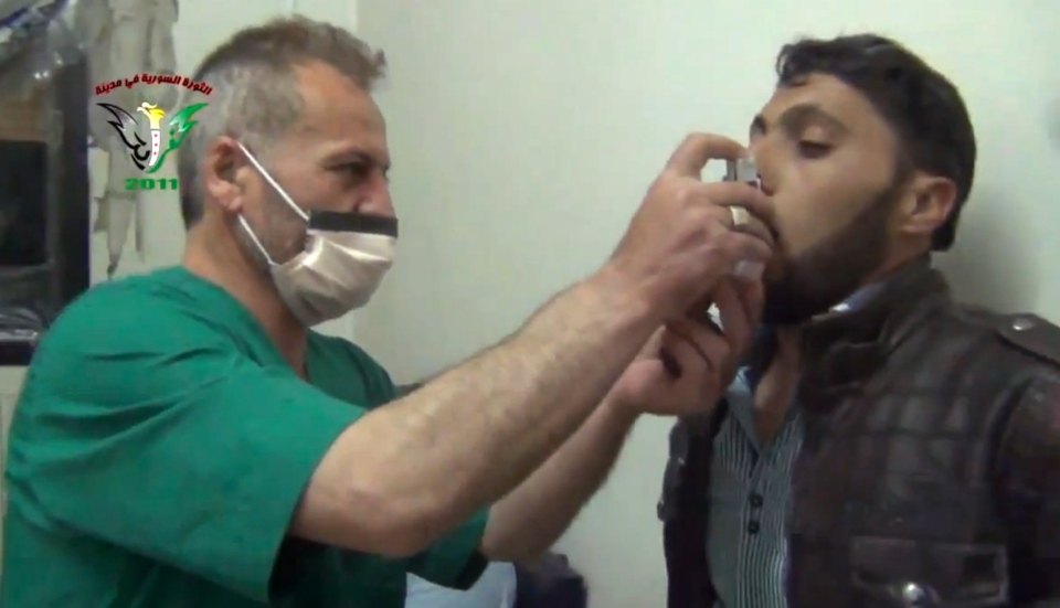 A Syrian man is treated with an inhaler in Kfar Zeita, a rebel-held village in Hama province some 200 kilometres north of Damascus in  this image taken from video obtained from the Shaam News Network and posted on April 18, 2014. The image has been authenticated based on its contents and other AP reporting,