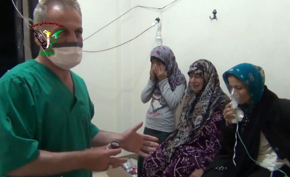 Two women and a young girl are treated by a medic in Kfar Zeita, a rebel-held village in Hama province some 200 kilometres north of Damascus, in this image taken from video obtained from the Shaam News Network and posted on April 18, 2014. The image has been authenticated based on its contents and other AP reporting,