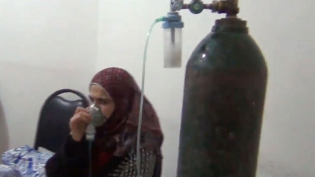 Syria activists accuse Assad of gas attack