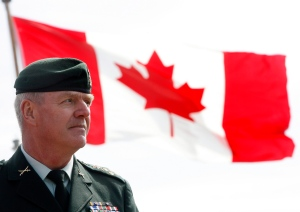 In this file photo, Rick Hillier stands in front of a Canadian flag during the departure ceremony for HMCS Iroquois at HMC Dockyard in Halifax Saturday morning, April 19, 2008. (Mike Dembeck / THE CANADIAN PRESS)
