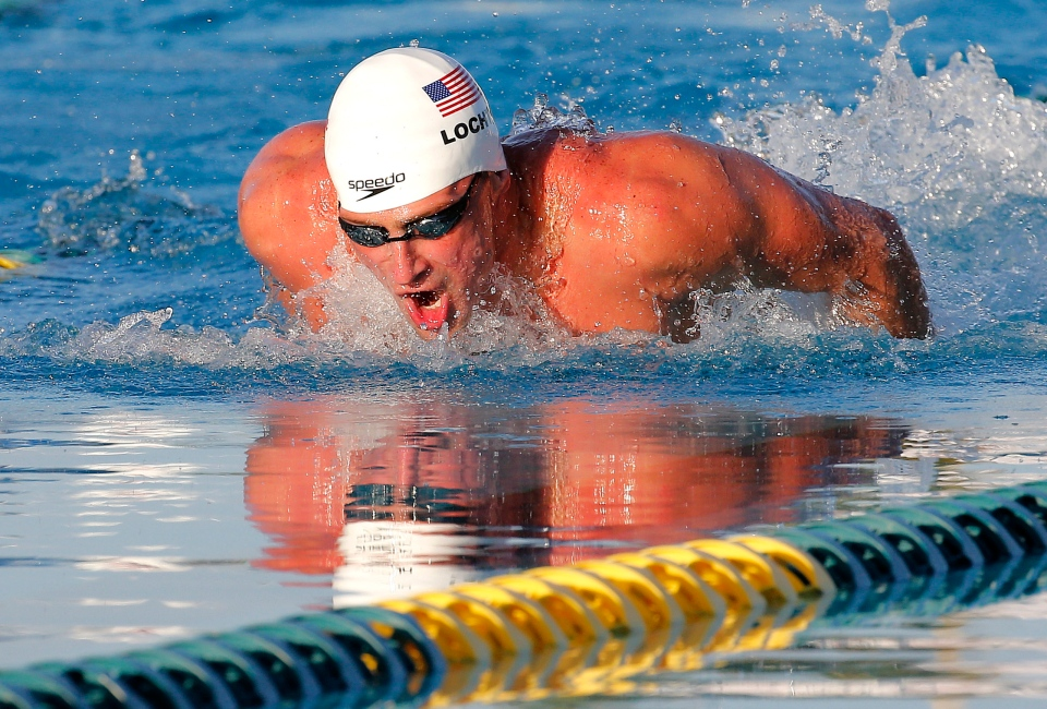 Ryan Lochte competes in the 100-metre butterfly final during the Arena Grand Prix swim meet in Mesa, Ariz, Thursday, April 24, 2014. (AP / Matt York)