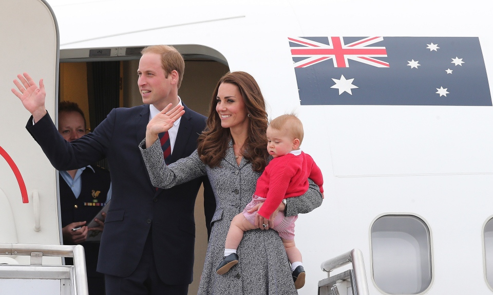 Prince William and Kate, the Duchess of Cambridge, with son Prince George, as they board their flight in Canberra, Australia, Friday, April 25, 2014. (AP / Rob Griffith)