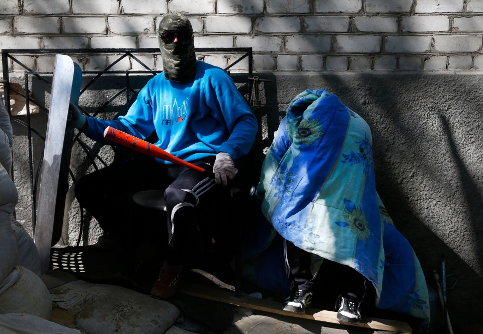 Pro-Russian masked militants guard barricades in Slovyansk , eastern Ukraine, Friday, April 25, 2014. (AP / Sergei Grits)
