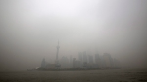 In this Monday, Dec. 9, 2013 photo, the skyline of the Lujiazui Financial District with the high-rise buildings is covered with heavy smog in Pudong in Shanghai, China. (AP / Eugene Hoshiko, File)