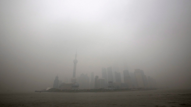 Shanghai, China skyline shrouded by smog