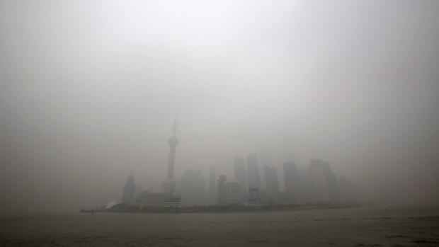 Shanghai, China skyline shrouded by smog