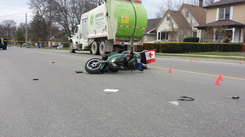 One man is dead following a crash between a moped and a recycling truck in Tillsonburg, Ont., as seen in this photo provided by OPP.