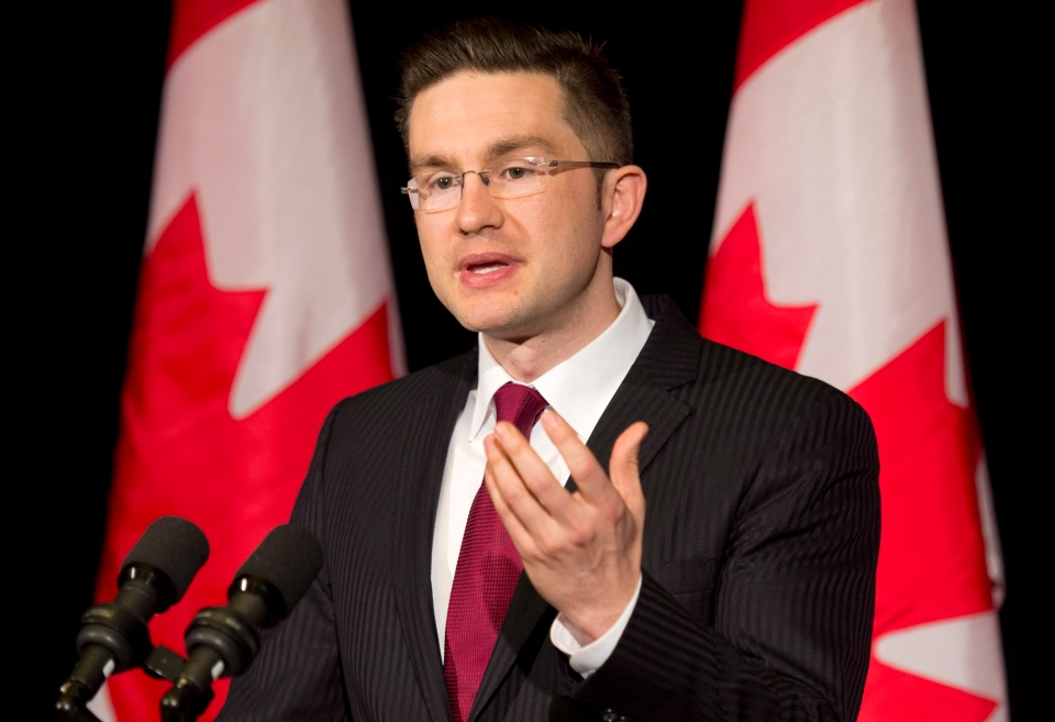 Minister of State (Democratic Reform) Pierre Poilievre speaks with the media about the Supreme Court decision on the Senate and the Fair Elections Act during a news conference in Ottawa, Friday, April 25, 2014. (Adrian Wyld / THE CANADIAN PRESS)