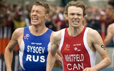 Canada's Simon Whitfield races Igor Sysoev of Russia to the finish line during the Elite Men's World Triathlon in Vancouver, Sunday, June 8, 2008. (Jonathan Hayward / THE CANADIAN PRESS)