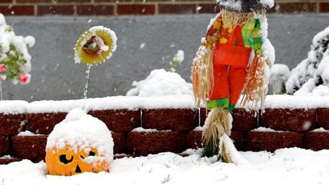 Halloween decorations are covered with snow on a day when the Northern New Jersey region was hit with a rare October snowstorm in North Bergen, N.J., Saturday, Oct. 29, 2011. (AP / Julio Cortez)