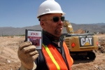 Film Director Zak Penn shows a box of a decades-old Atari 'E.T. the Extra-Terrestrial' game found in a dumpsite in Alamogordo, N.M., Saturday, April 26, 2014. (AP / Juan Carlos Llorca)