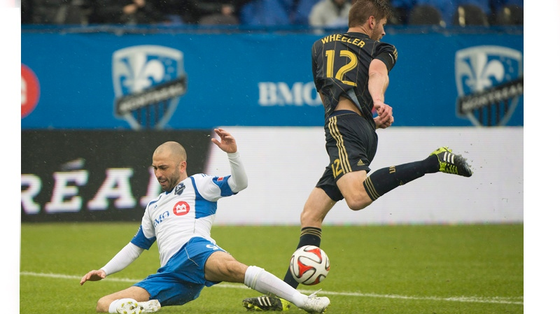 Montreal Impact's Marco Di Vaio, left, is brought down by Philadelphia Union's Aaron Wheeler during first half MLS soccer action in Montreal, Saturday, April 26, 2014. THE CANADIAN PRESS/Graham Hughes