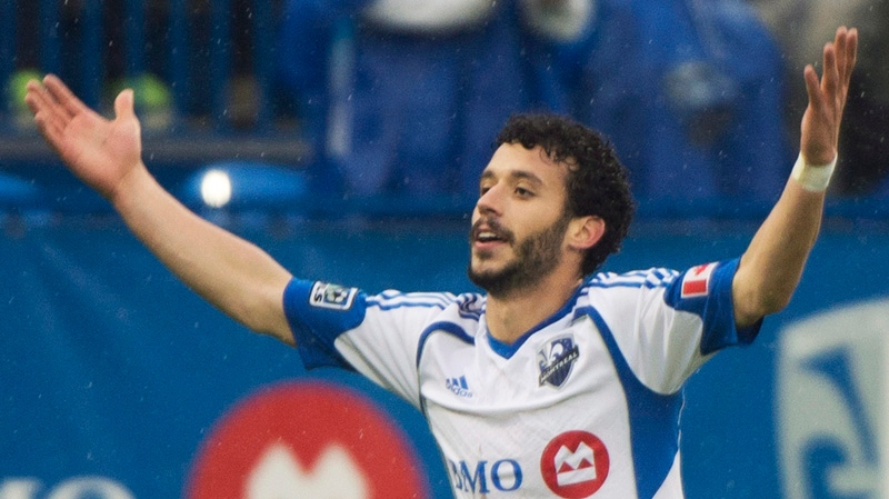 Montreal Impact's Felipe Martins celebrates after scoring against the Philadelphia Union during first half MLS soccer action in Montreal, Saturday, April 26, 2014. THE CANADIAN PRESS/Graham Hughes