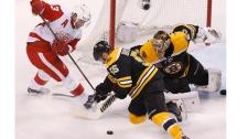 Boston Bruins' Tuukka Rask (40) and Johnny Boychuk