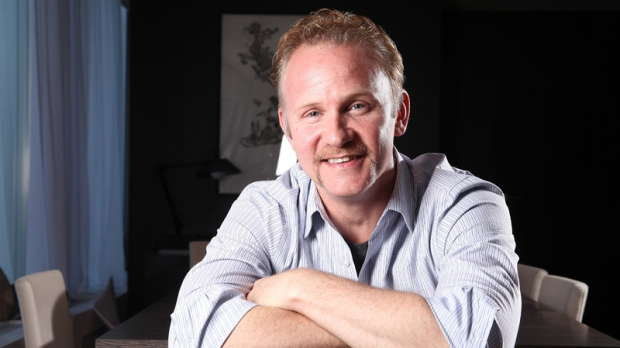 In this Sept. 11, 2011 photo, director Morgan Spurlock poses for a portrait during the 36th Toronto International Film Festival in Toronto, Canada. (AP / Carlo Allegri)