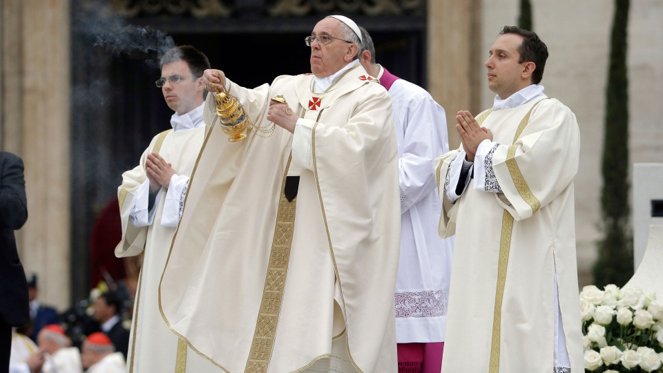 Pope Francis asperses incense as he leads a solemn celebration in St. Peter's Square at the Vatican, Sunday, April 27, 2014. (AP / Andrew Medichini)