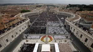 A view of St. Peter's Square filled with faithful during a solemn ceremony led by Pope Francis at the Vatican, Sunday, April 27, 2014.  (AP / Andrew Medichini)