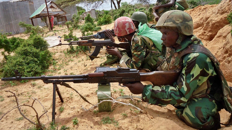 In this Oct. 20, 2011 file photo, African Union peacekeepers hold their positions in the Deynile district of Somalia's capital, Mogadishu, after al-Shabab was chased out of the neighborhood in a dawn offensive by Somali government troops and African Union peacekeepers.