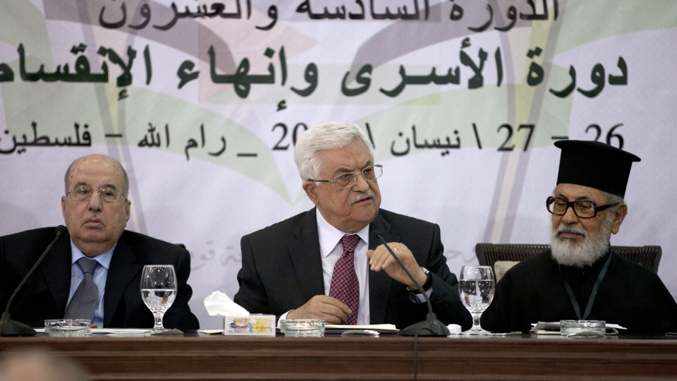 Palestinian President Mahmoud Abbas, middle, speaks during a meeting with the Palestinian Central Council, a top decision-making body, at his headquarters in the West Bank city of Ramallah, Saturday, April 26, 2014. (AP / Majdi Mohammed)