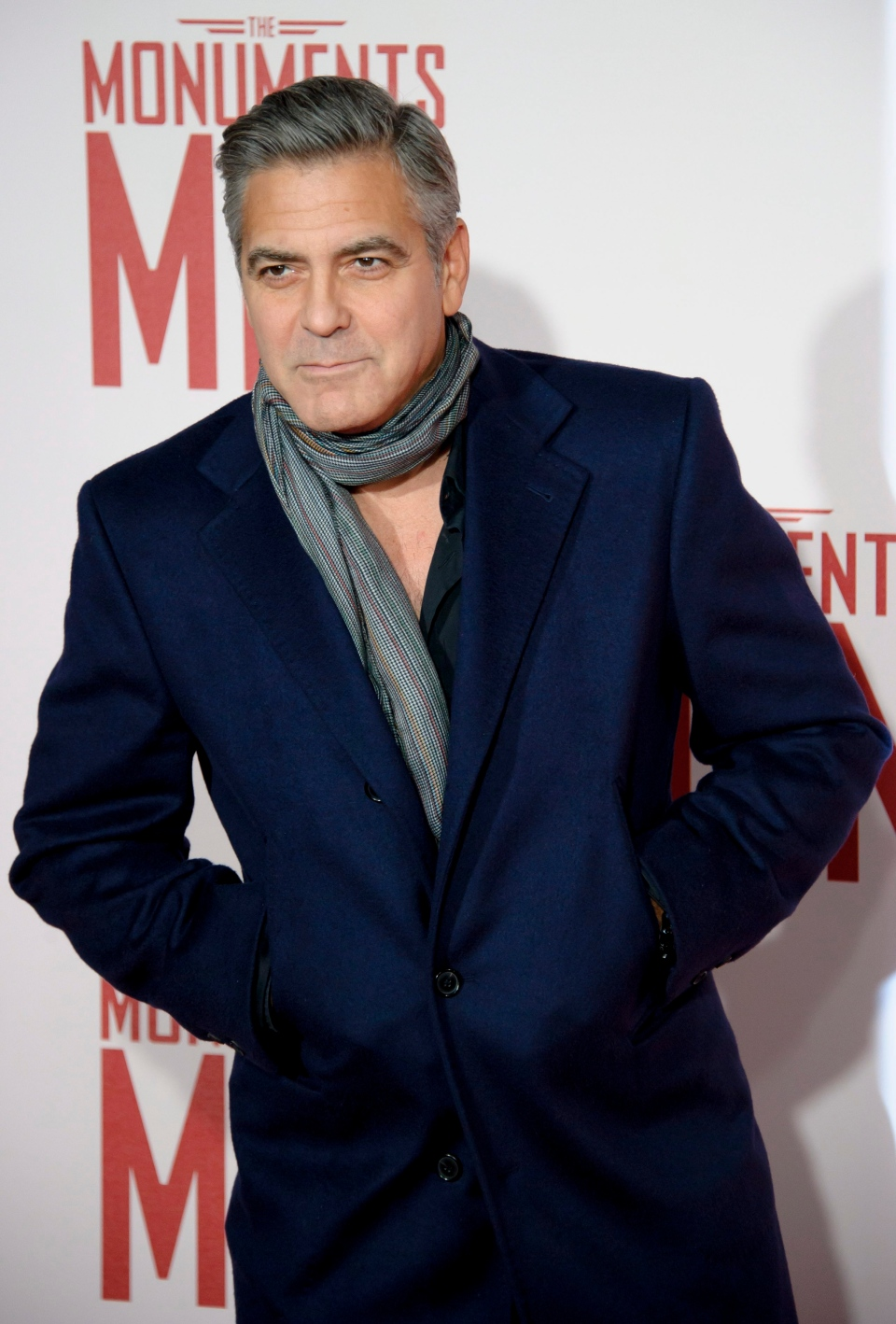 "George Clooney arrives for the U.K. premiere of ""The Monuments Men"" at a central London cinema, London, Tuesday, Feb. 11, 2014. (Photo by Jonathan Short/Invision/AP)"