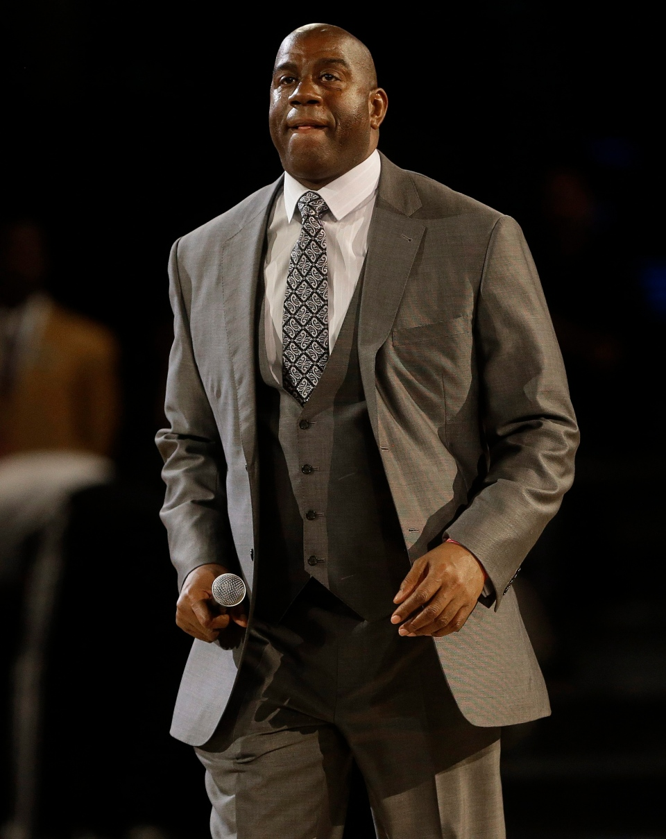 Former NBA player Earvin 'Magic' Johnson, Jr. walks on the court during the NBA All Star basketball game on Sunday, Feb. 16, 2014, in New Orleans. (AP / Gerald Herbert)