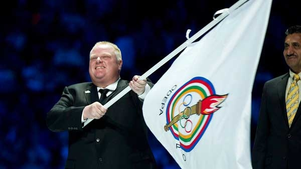 Toronto Mayor Rob Ford carries the Pan American games flag in Omnilife Stadium during the closing ceremonies of the 2011 Pan American Games in Guadalajara, Mexico on Sunday, Oct. 30, 2011.