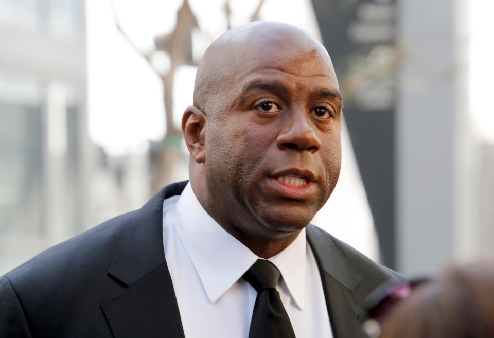 Rormer Los Angeles Lakers player Earvin 'Magic' Johnson is shown in Los Angeles on Feb. 21, 2014. Johnson is calling upon NBA Commissioner Adam Silver to 'come down hard' on Los Angeles Clippers owner Donald Sterling, who is alleged to have made racially charged comments. (AP / Reed Saxon)