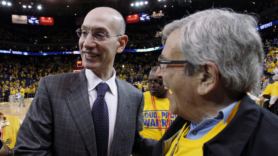 NBA commissioner Adam Silver, left, shakes hands with a fan after Game 4 of an opening-round NBA basketball playoff series between the Golden State Warriors and Los Angeles Clippers in Oakland, Calif., Sunday, April 27, 2014. (AP / San Francisco Chronicle, Carlos Avila Gonzalez)