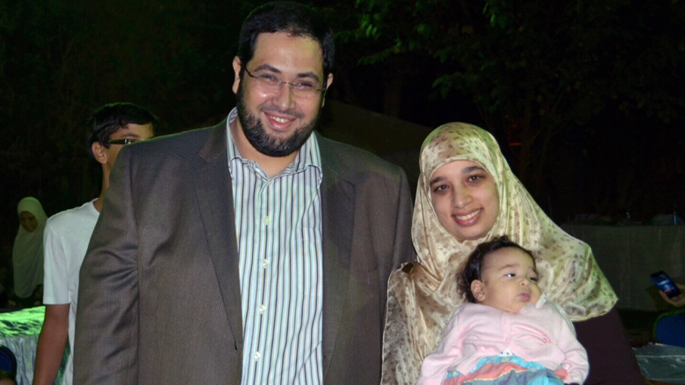 Khaled Al-Qazzaz (left) is pictured with his wife Sarah Attia is this undated photo.