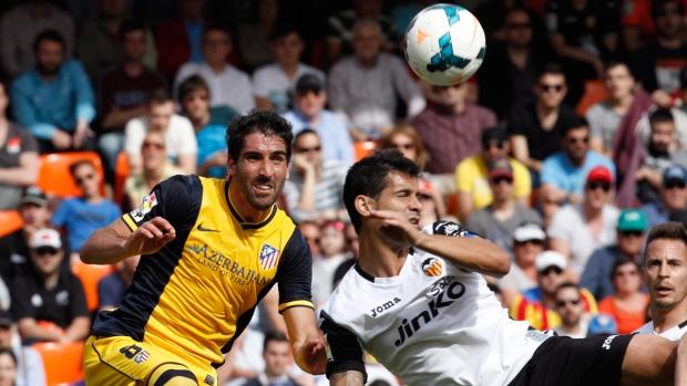 Atletico de Madrid and Valencia in action