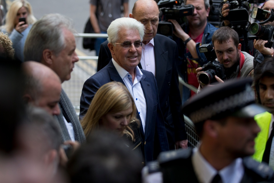British public relations agent Max Clifford, centre, pauses to pose for members of the media as he leaves his trial at Southwark Crown Court in London on Monday, April 28, 2014. (AP / Matt Dunham)
