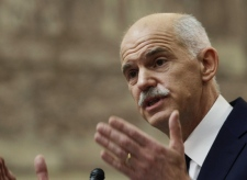 Greek Prime Minister George Papandreou addresses Socialist lawmaker members of parliament in Athens, in Athens, on Thursday, Nov. 3, 2011. (AP / Petros Giannakouris)
