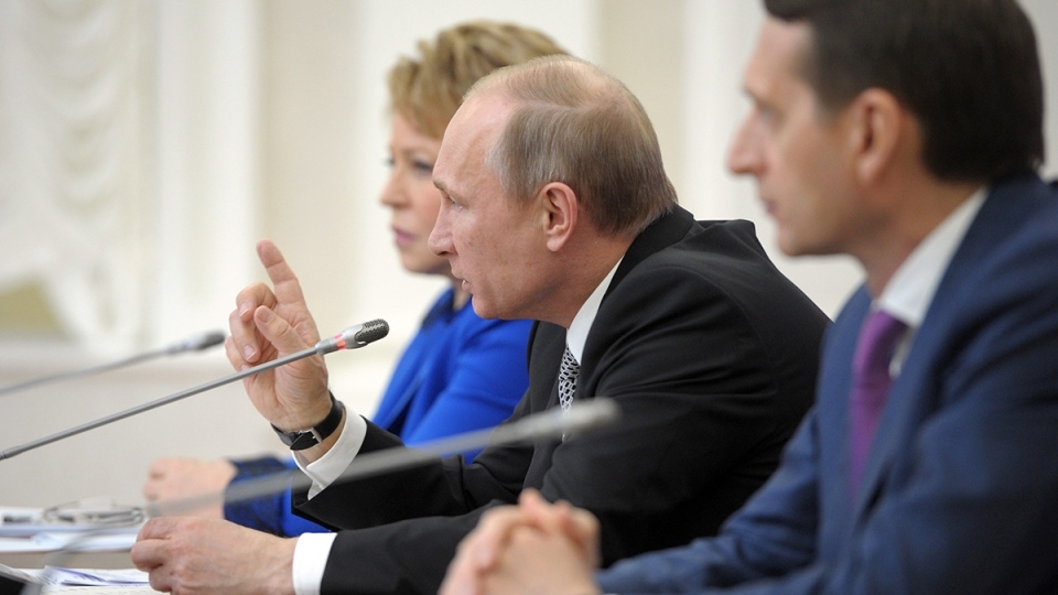 Russian President Vladimir Putin speaks during a meeting with Russian lawmakers in the city of Petrosavodsk, some 660 kilometres north of Moscow, on Monday, April 28, 2014. (RIA Novosti / Alexei Druzhinin, Presidential Press Service)