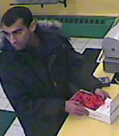 Police say a suspect grabbed a box of poppies off a Pizza Nova counter on The Queensway near Royal York around late Monday.